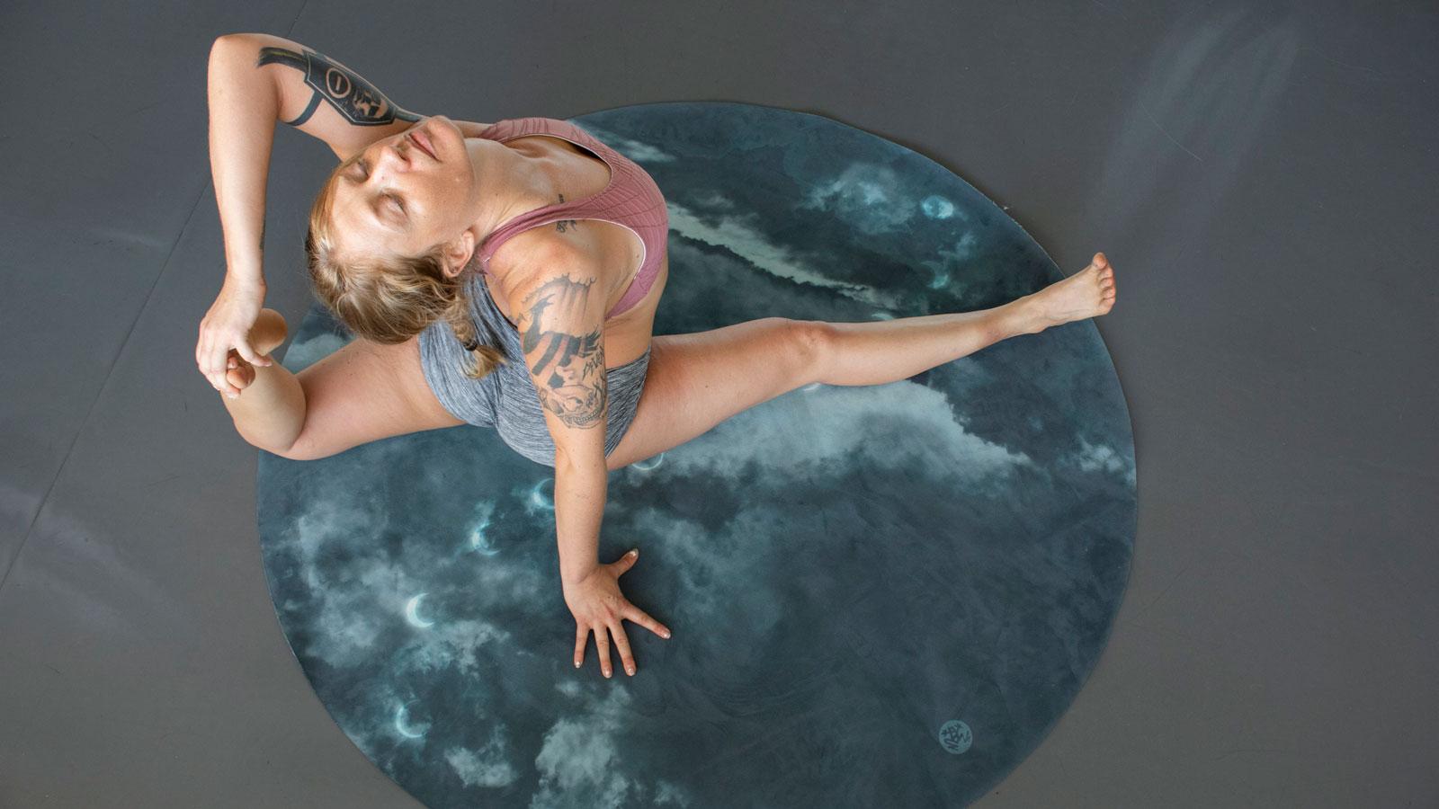 Cassandra Johnson, a yoga instructor, practices yoga.