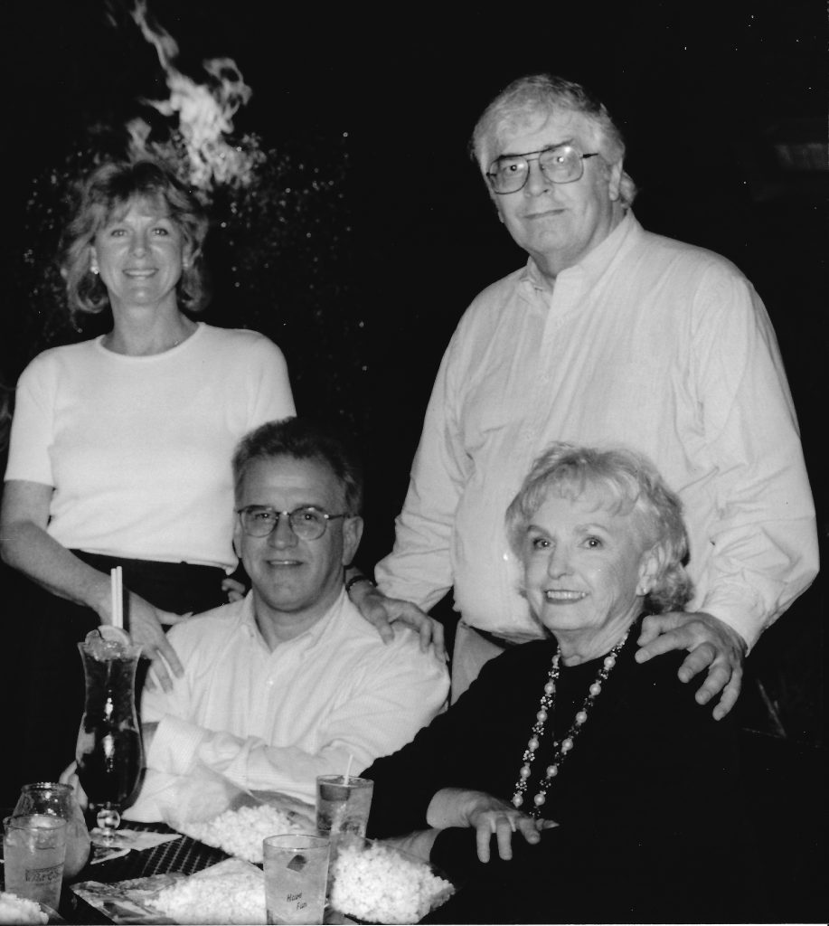 black and white photo of four people