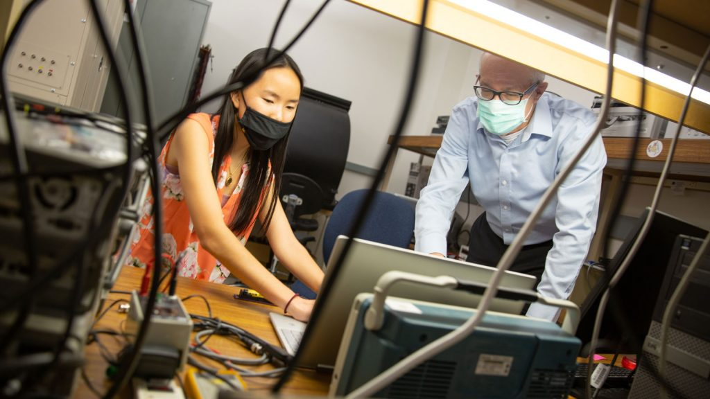 Electrical engineering major Kylie Welch and Professor David Allee work in his lab.