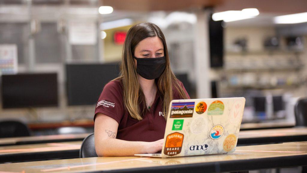 Biomedical engineering senior Lauren Lossner works on a laptop.