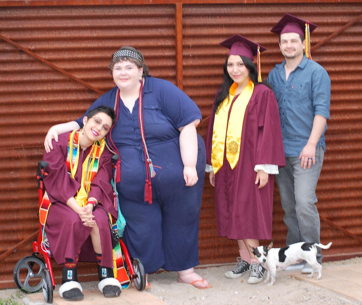 Nicole Haikalis, Sarah Davis, Analisa Benites and Lydan McLaws pose for a graduation photo.