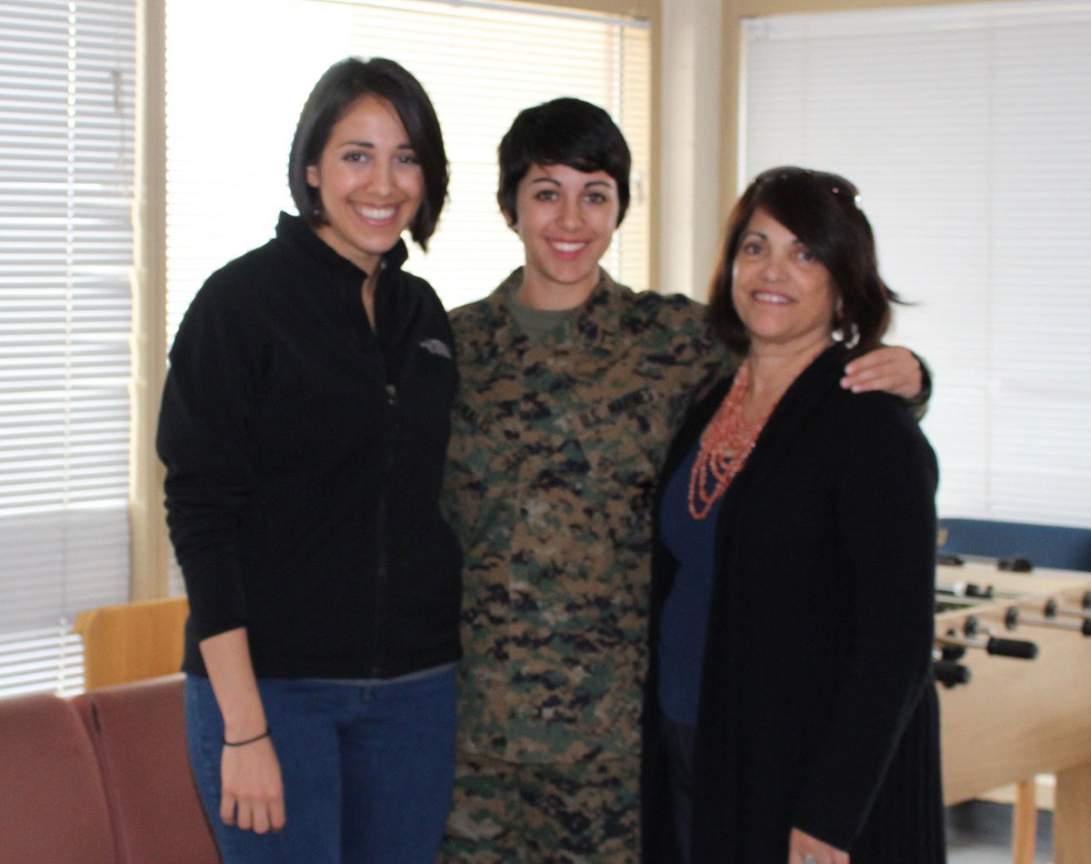 A photo of Nicole Haikalis (center), her sister, Michelle (left), and mom, Susana (right).