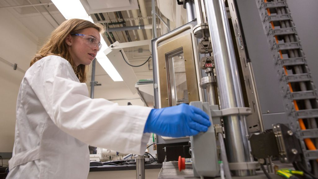 Chemical engineering senior Alexis Hocken works with machinery in the lab.