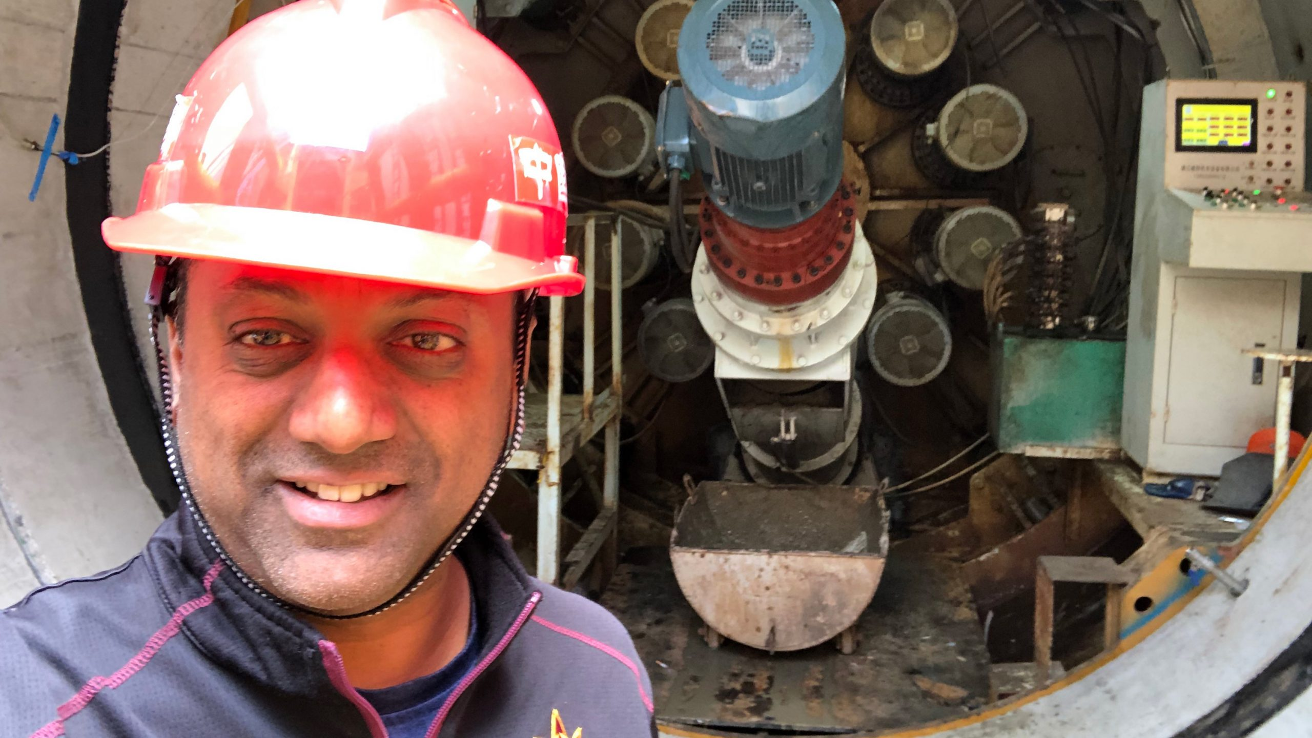 Sam Ariaratnam in front of a pipe