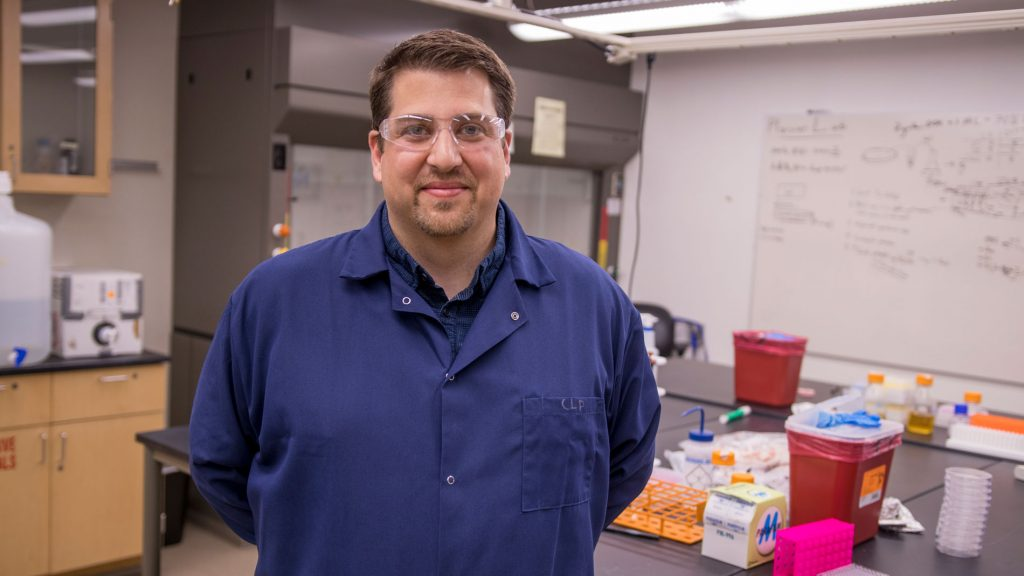 Christopher Plaisier poses in his lab at Arizona State University.