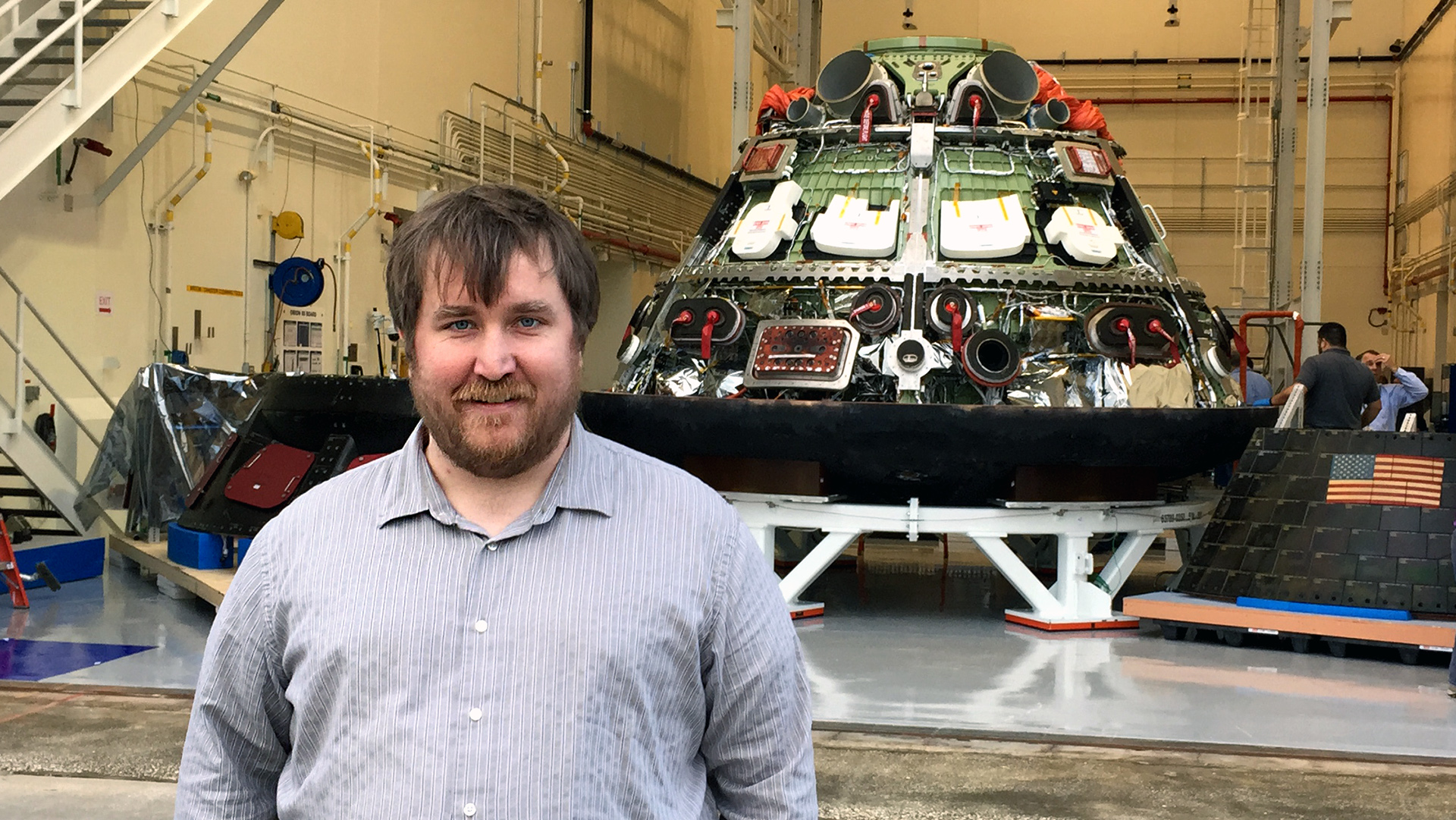 Zach Pirtle in front of an Orion spacecraft