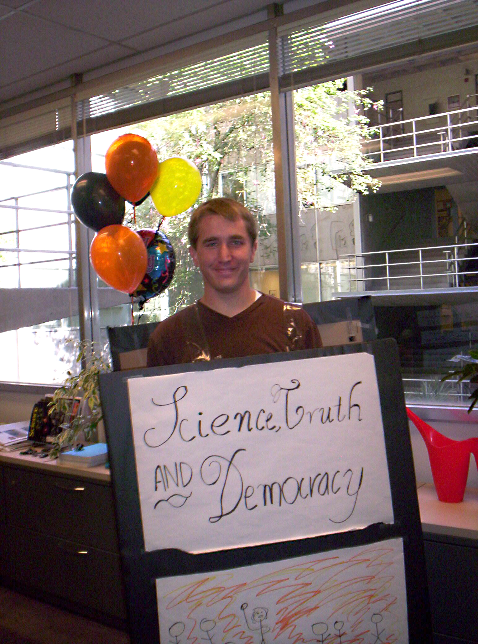 """Zachary Pirtle dressed as philosopher Philip Kitcher's book """"Science, Truth and Democracy."""""""