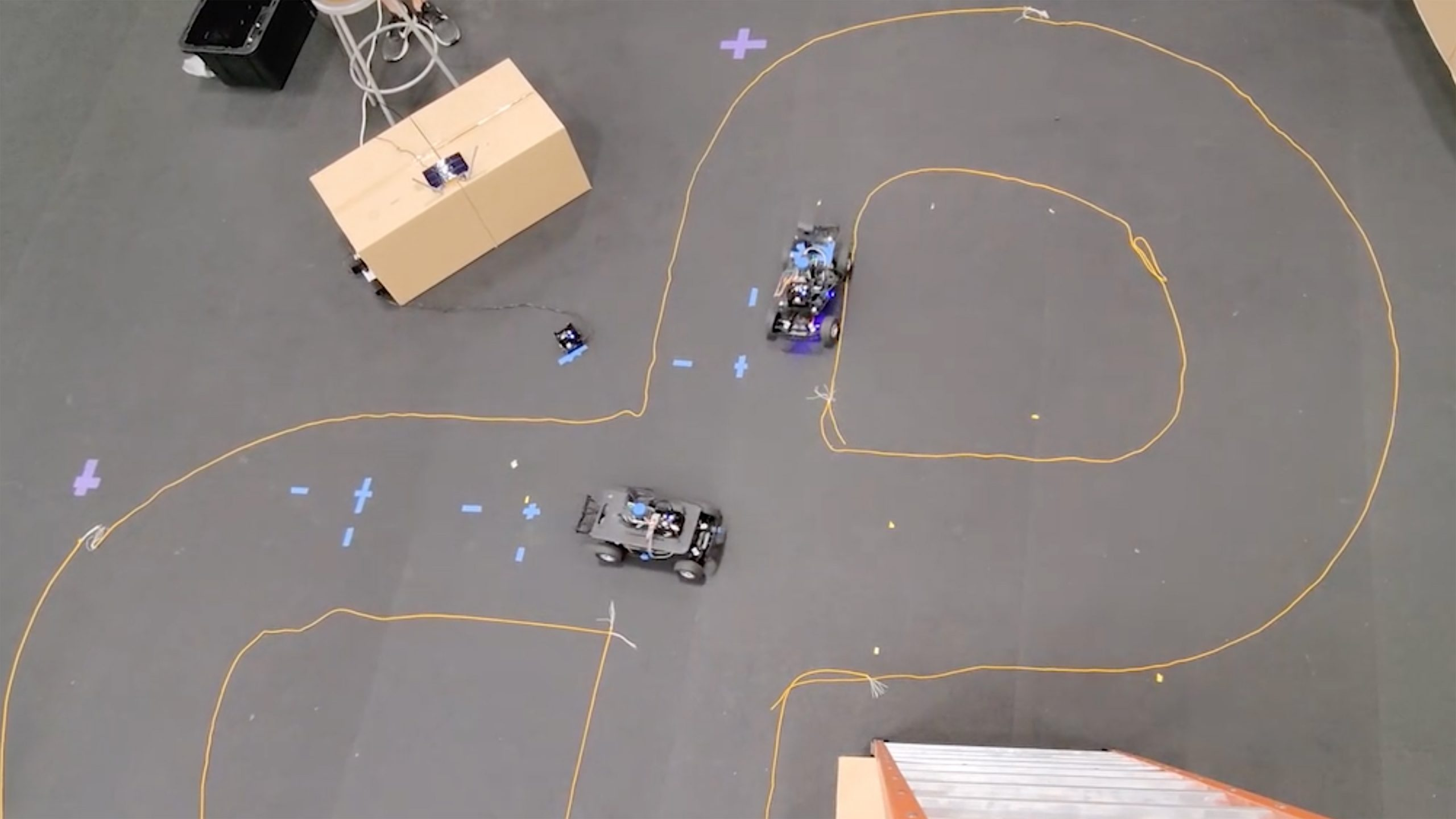 pair of autonmous vehicles driving in a figure-eight track