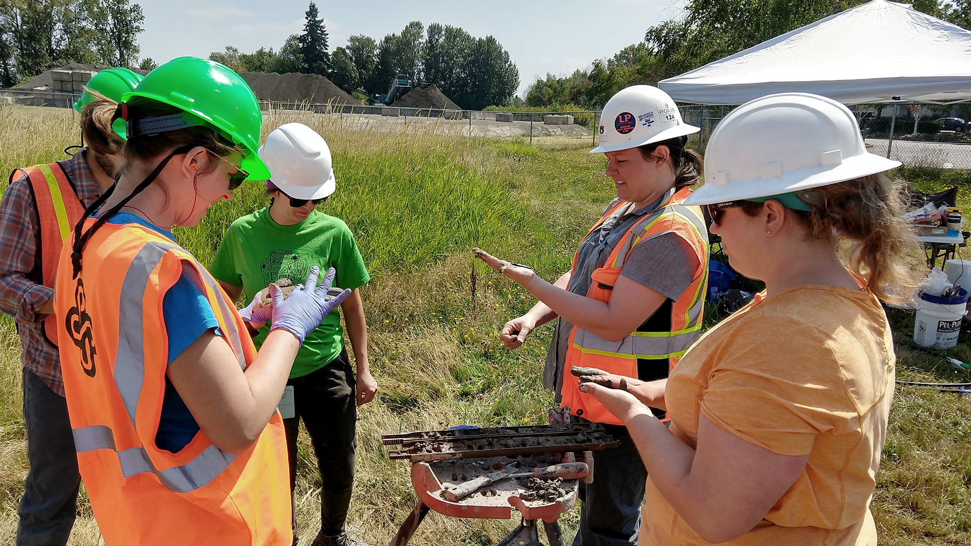 A group of students in hard hats working outdoors