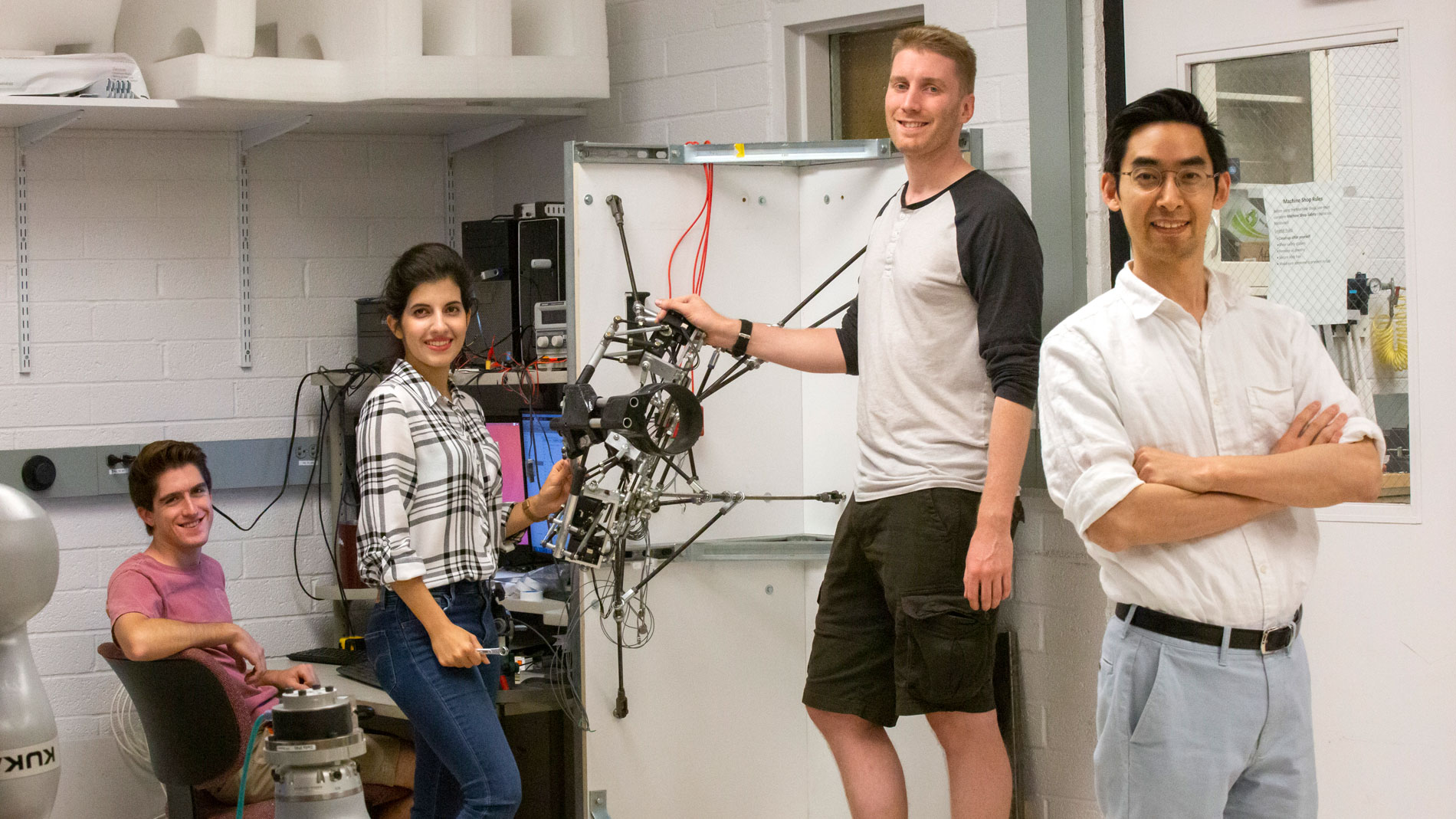 Assistant Professor Hyunglae Lee (right) and his students in the Neuromuscular Control and Human Robotics Laboratory.