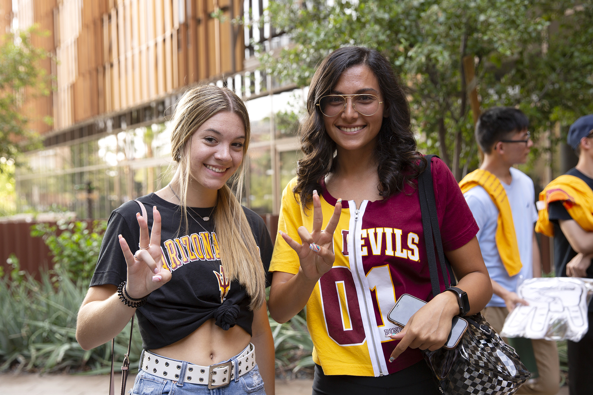 Two new students wearing ASU shirts