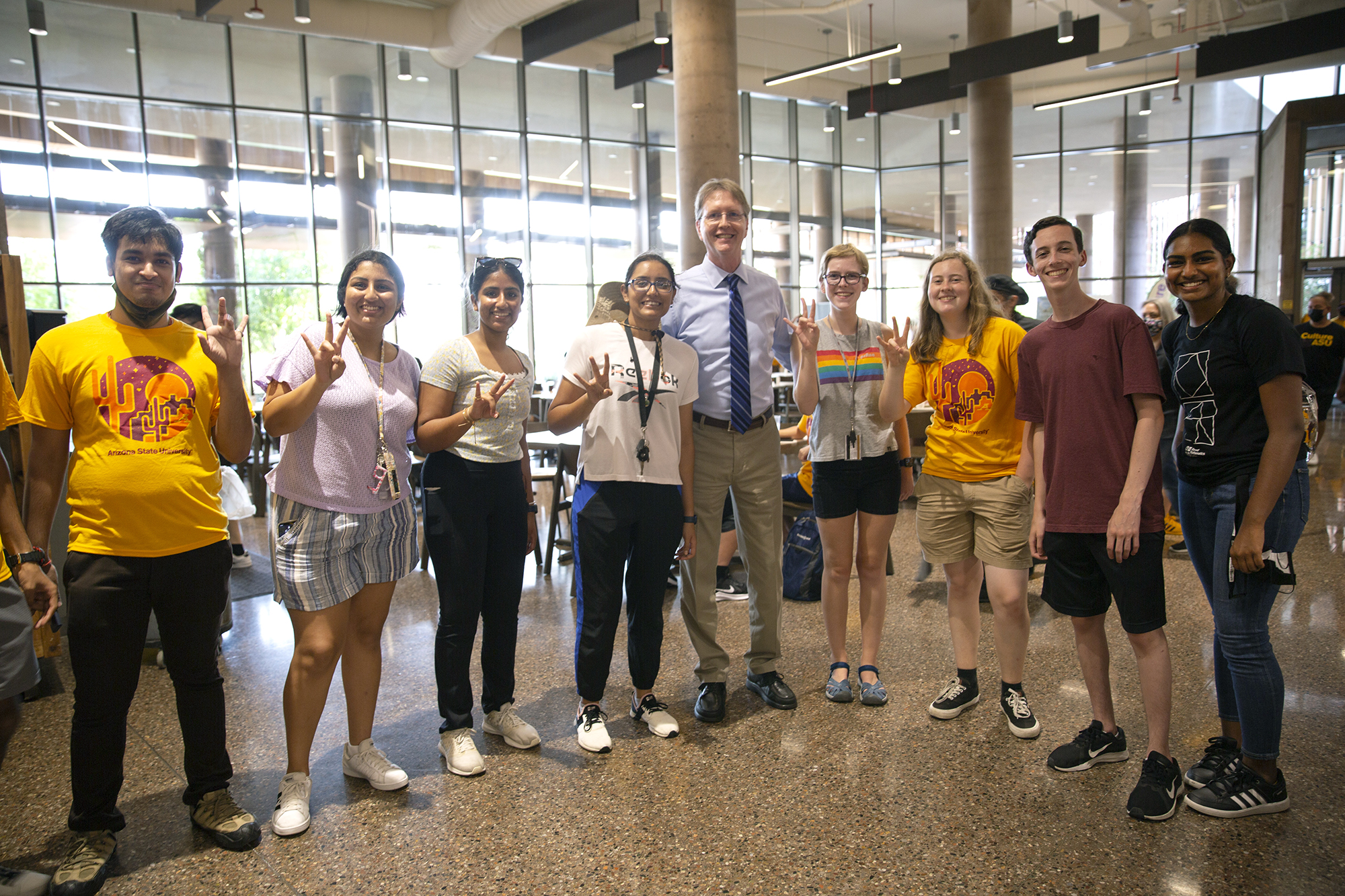 new students standing with Dean Kyle Squires