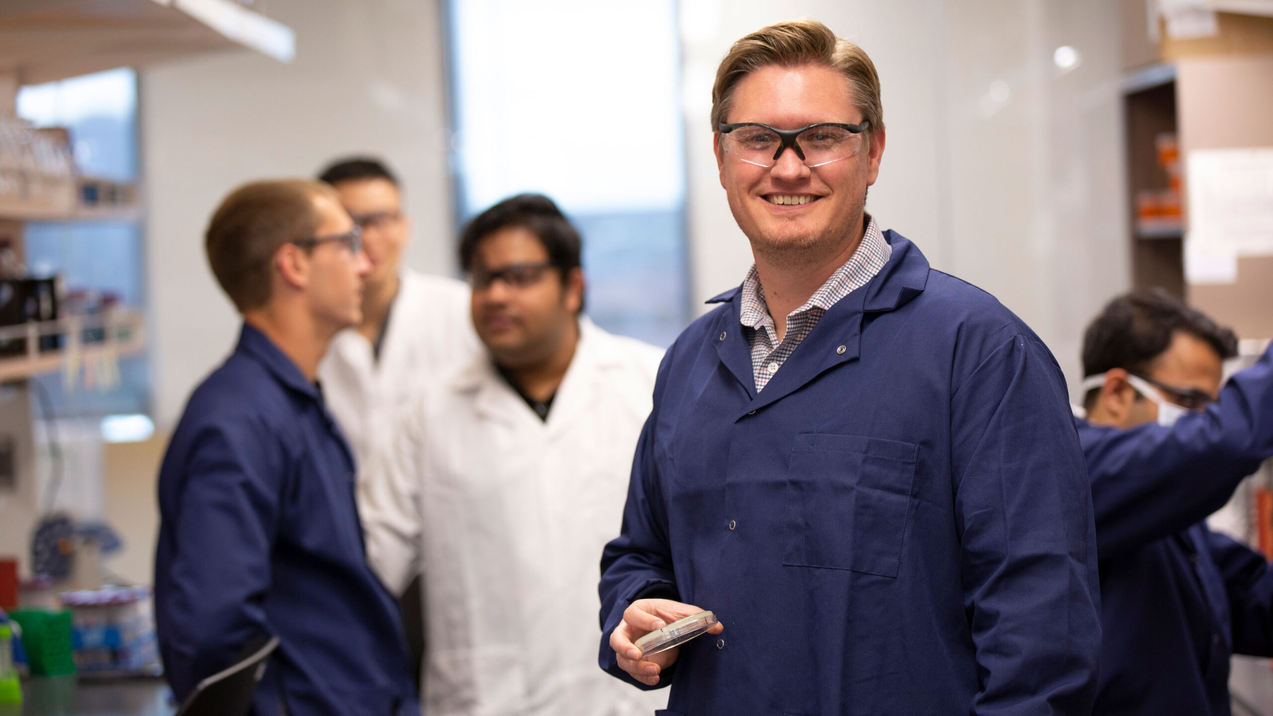 Brent Nannenga in a lab with students