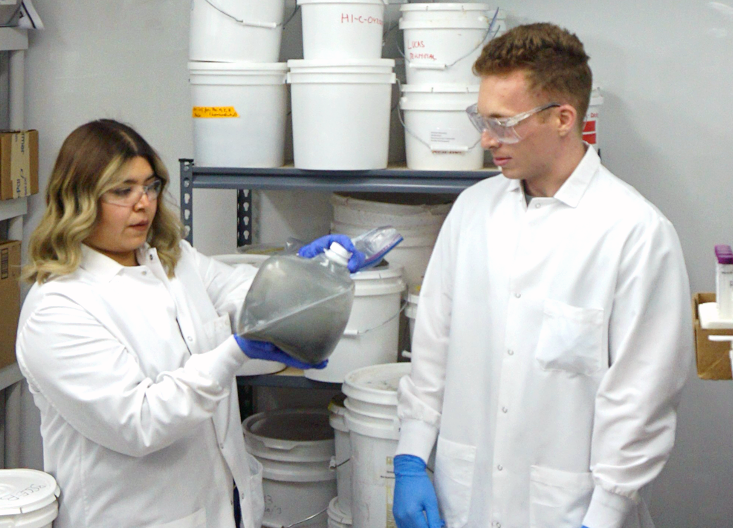 Aide Robles and Maxwell Silverman preparing samples in the lab