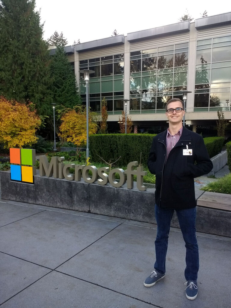 Ira A. Fulton Schools of Engineering electrical engineering alumnus Richard Rigby poses in front of a Microsoft sign in Redmond, Washington.