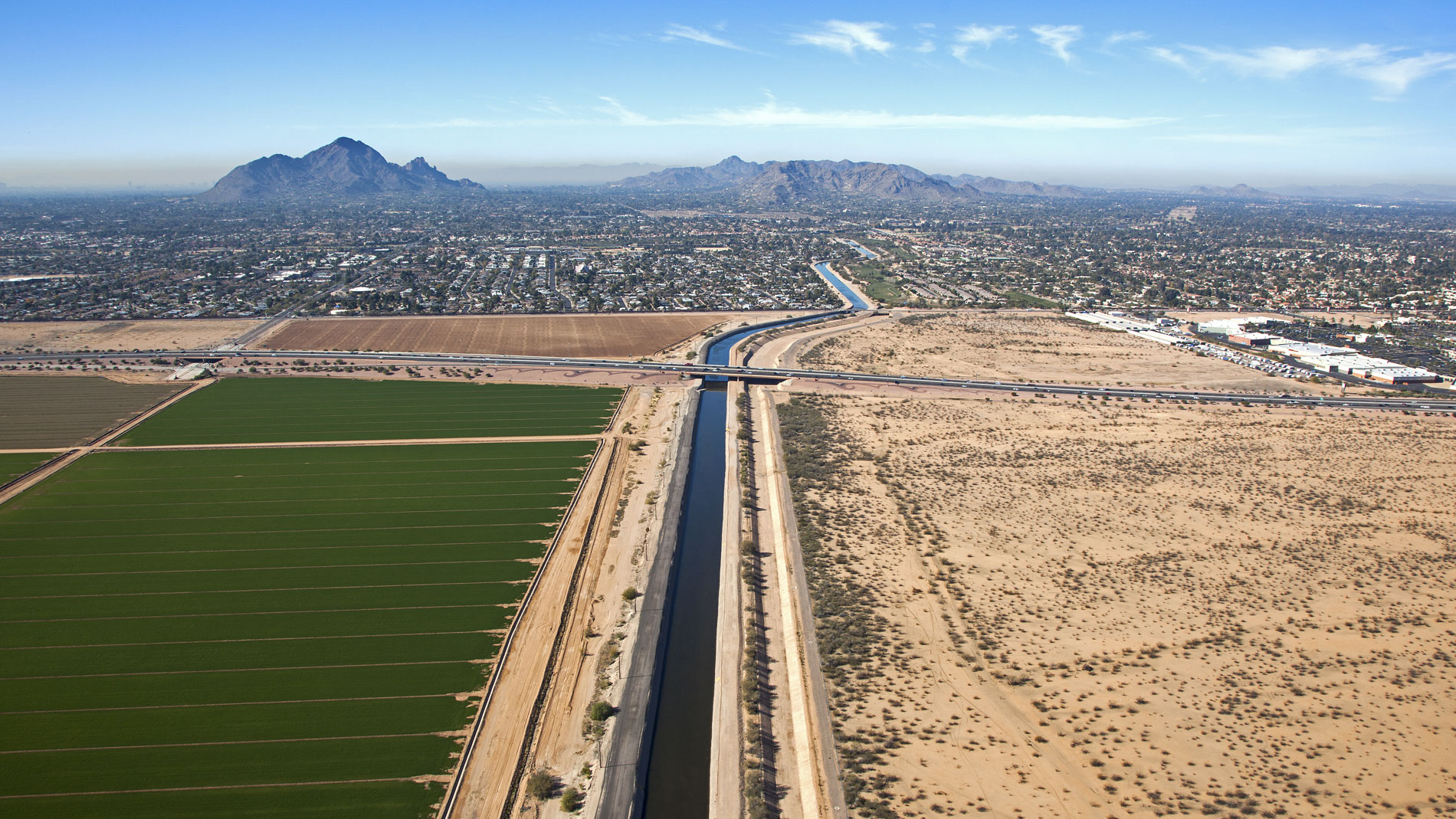 An irrigation canal running near agricultural fields in the Phoenix metropolitan area.