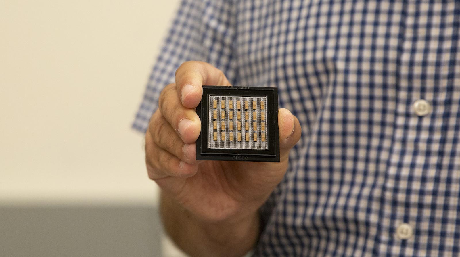 Saeed Zeinolabedinzadeh holding a circuit chip